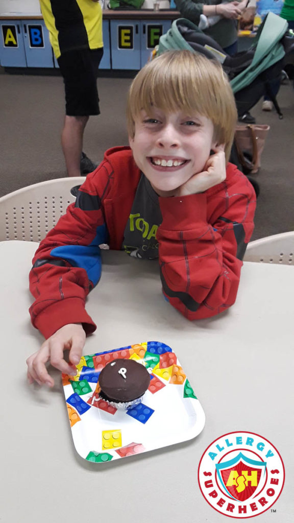 Our happy son with is food allergy safe for him cupcake (from Better Bites) at a birthday party by Allergy Superheroes.