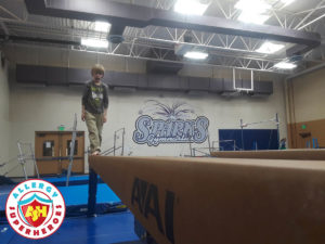 Zax walking the balance beam at a food allergy inclusive birthday party by Allergy Superheroes.