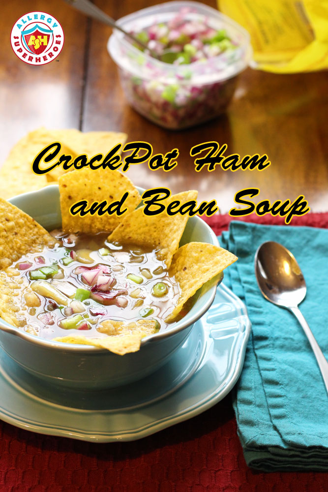 "Bowl of soup with tortilla chips and onion garnish | words read ""CrockPot Ham and Bean Soup"" 