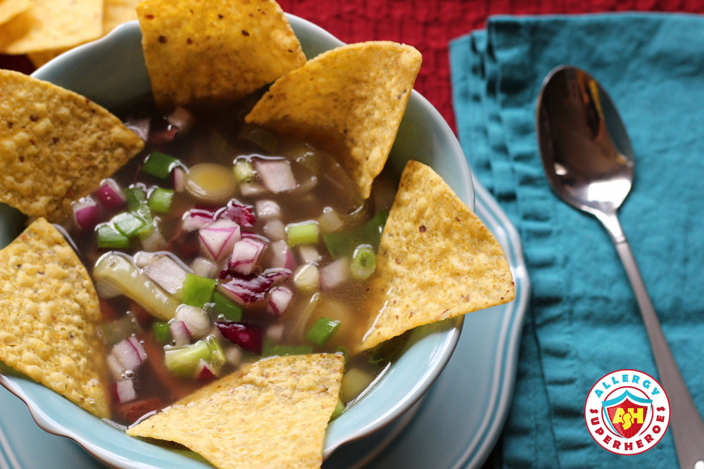 Bowl of soup with tortilla chips and onion garnish | by Food Allergy Superheroes