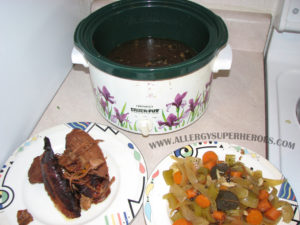 Ham and broth veggies removed with broth remaining in crockpot | by Food Allergy Superheroes
