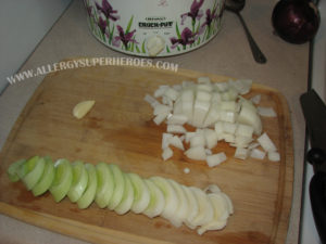 Chopped onions and chopped leek on wooden cutting board | by Food Allergy Superheroes