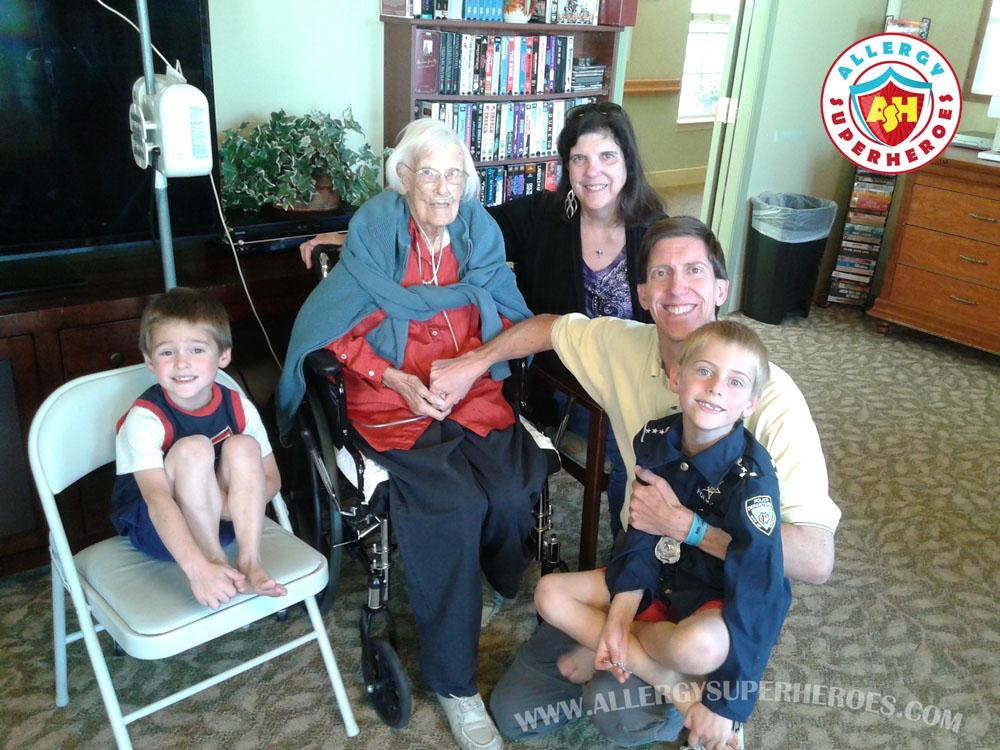 Family sitting with Grandma who has a feeding tube | by Allergy Superheroes