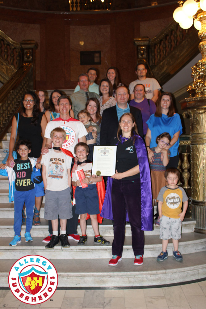 A group of 19 Coloradoans affected by Food Allergies standing with Governor Jared Polis, to celebrate the Food Allergy Week Proclamation | by Food Allergy Superheroes