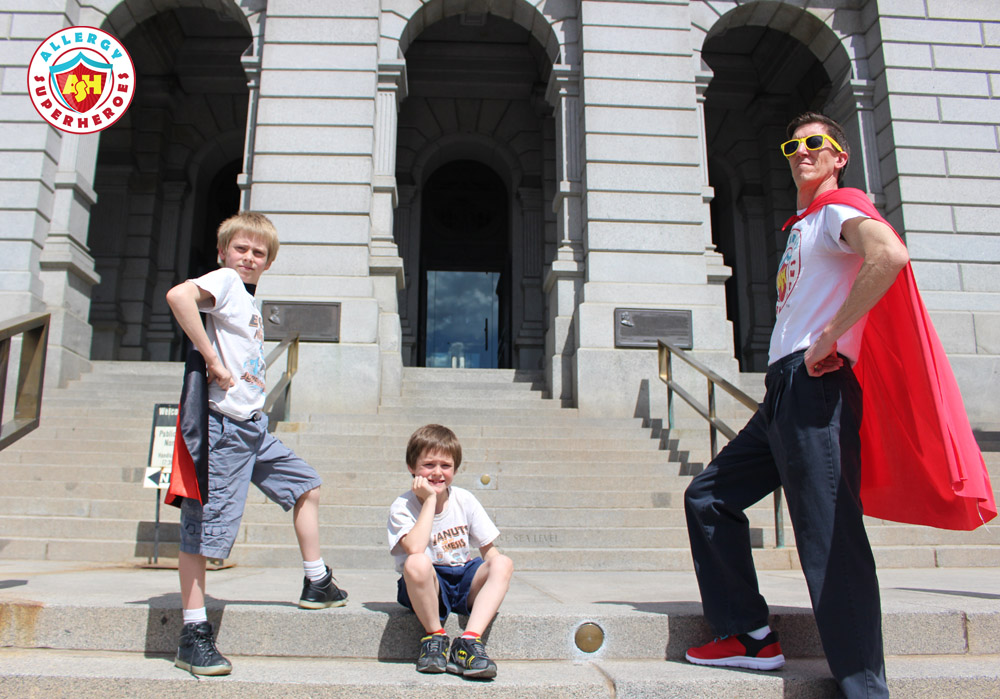 The Allergy Superheroes Family in superhero poses on the steps of the Colorado State Capitol | by Food Allergy Superheroes