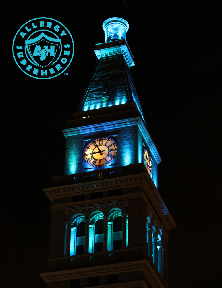 Denver's D&F Clock Tower on 16th Street Mall, with the top floors lit up Teal for Food Allergy Awareness | by Food Allergy Superheroes
