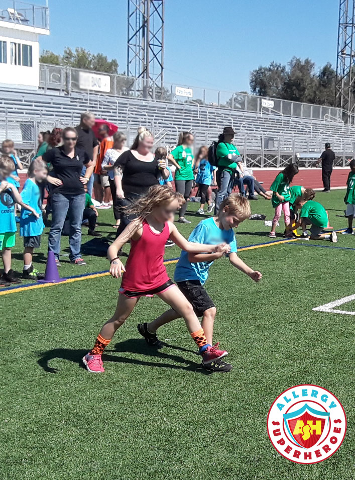 Children having a three legged race | Food Allergy Superheroes