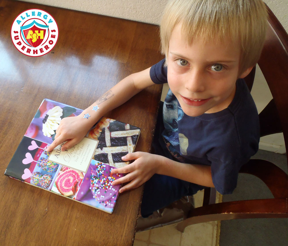 Child pointing to Cake Balls on cover of cookbook | Cookbook Review | Allergen Free Desserts | Food Allergy Superheroes