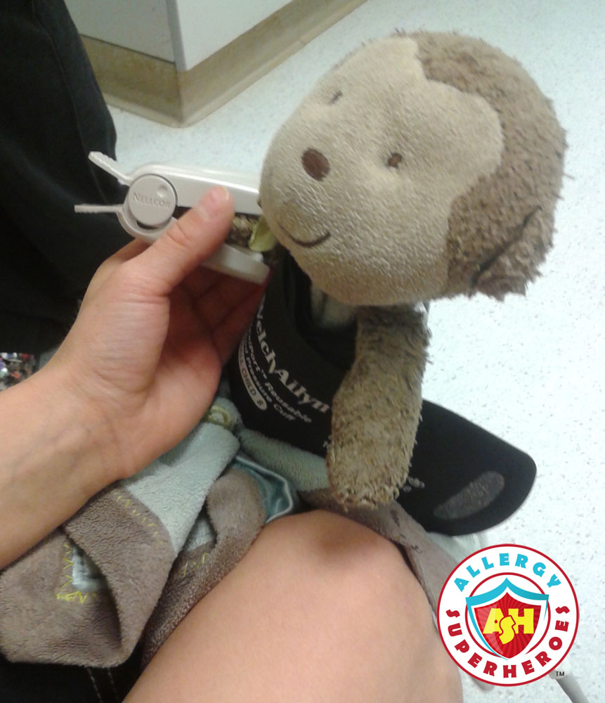 Stuffie getting its vitals taken | Food Allergy Superheroes