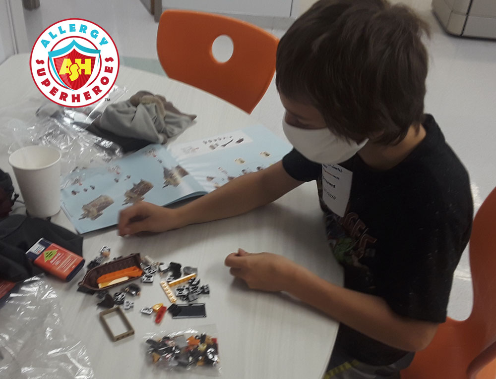 Building his prize during the peanut dosing waiting period | Food Allergy Superheroes