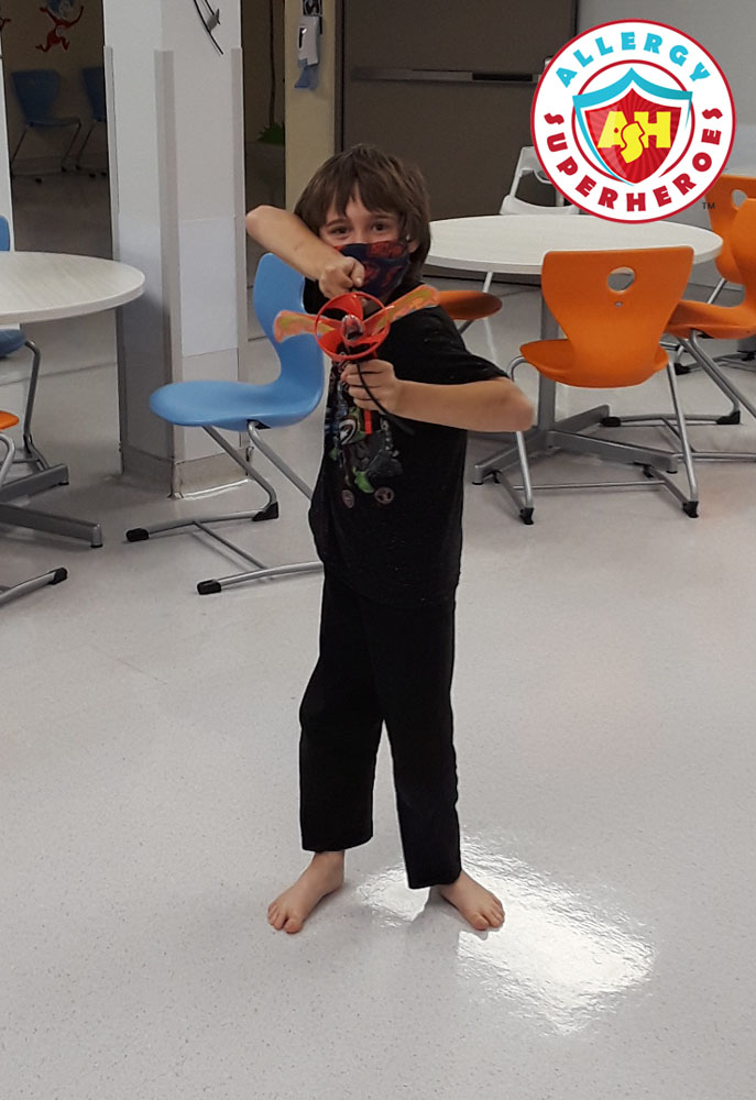 Recovering and enjoying his prize | Food Allergy Superheroes